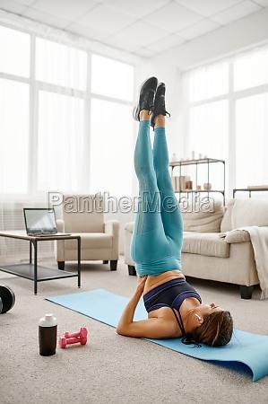 girl doing exercise on press online