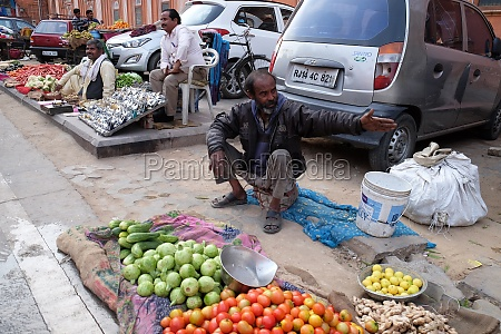 indian man selling fruit and vegetables