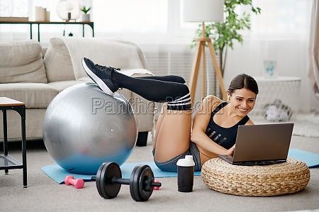 girl with ball online pilates training