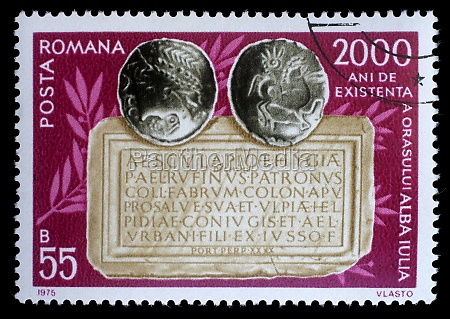 stamp printed in romania shows coins