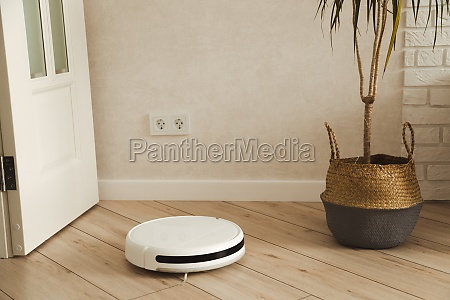 robotic vacuum cleaner cleaning living room