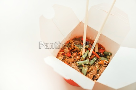 wok noodles in takeaway box wheat