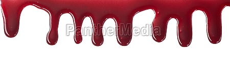 drips of bloody red cherry sauce
