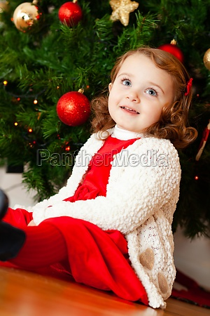 beautiful little child near christmas tree