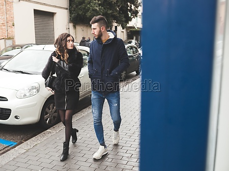 young couple walking in a winter