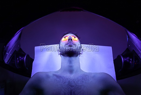young man at solarium in beauty
