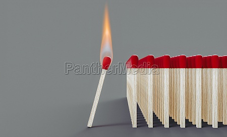 lit match approaching a group of