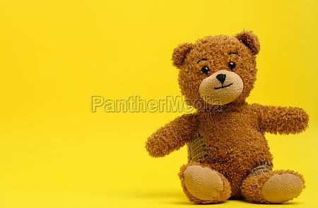 brown teddy bear sits on a