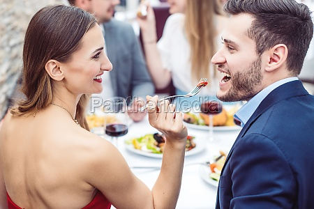 woman feeding her man with italian