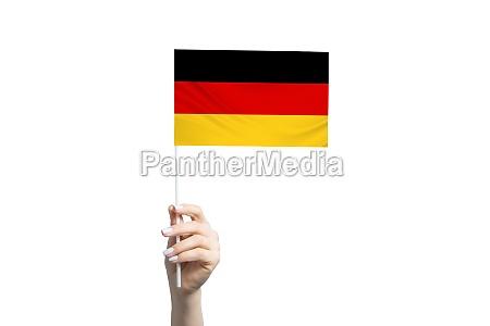beautiful female hand holding germany flag