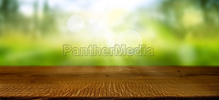 blurred spring landscape with wooden table