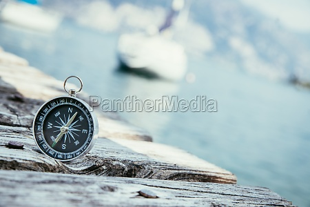 sailing nautical compass on wooden dock