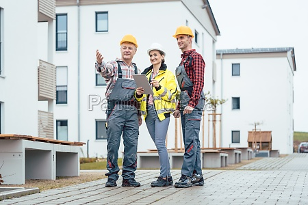 builder and contractor inspecting new houses