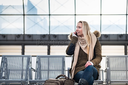 woman sitting on bench waiting for