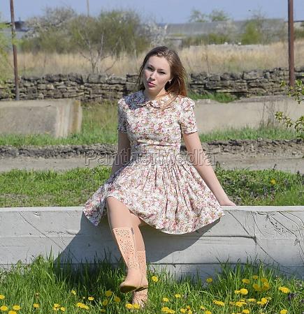a girl in a dress in