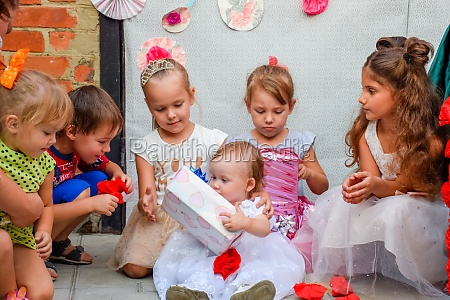 children are looking boxes with gifts