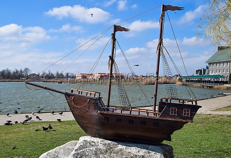 wooden boat with masts for sails