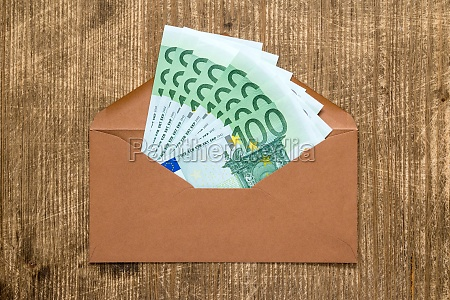 brown envelope with euro currency