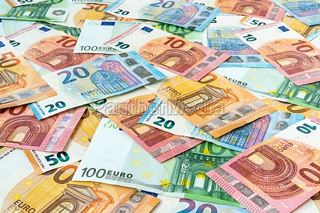 scattered euro currency banknotes