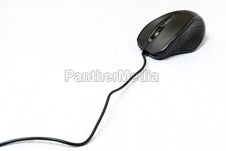 black computer mouse with cord