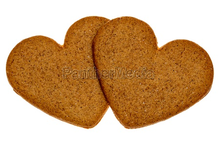 two gingerbread cookies in a heart