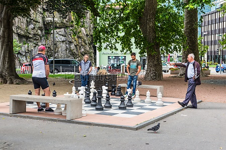 men playing chess on a giant