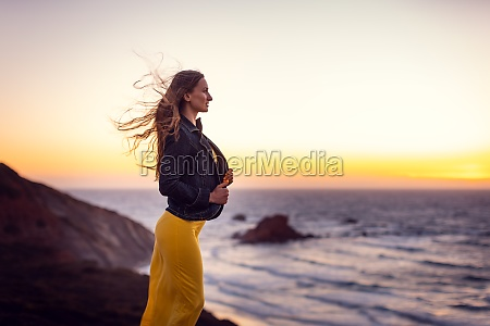 woman on a sunset beach with