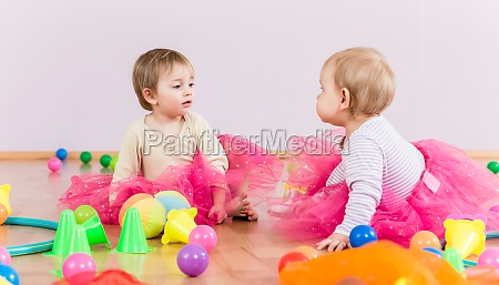 two toddlers playing together