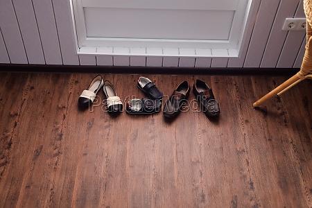 shoes near the door in hallway
