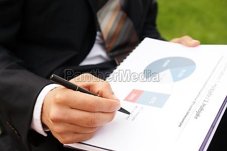 businessman evaluates company data and checks