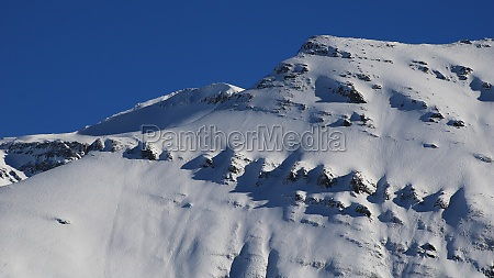 snow covered rock layers mount mittaghorn