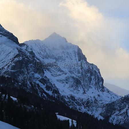 sun lit cloud over mount arpelistock