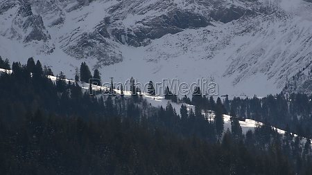 snow covered mountain ridge pine forest