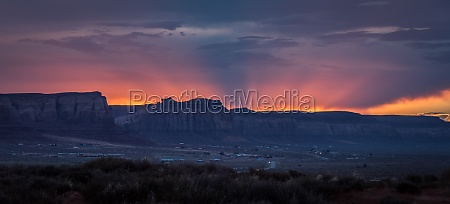 colorful red sunset near monument valley