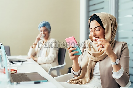 businesswoman in office using phone