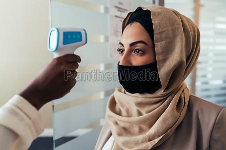 woman having temperature check