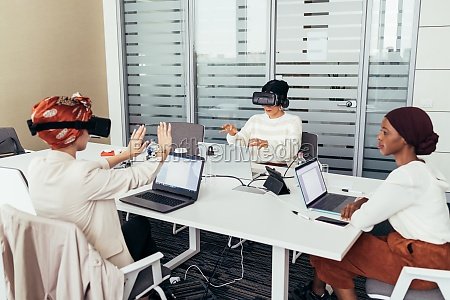colleagues using virtual reality headsets in