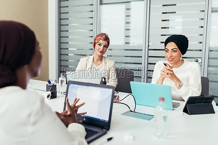 three female colleagues having discussion