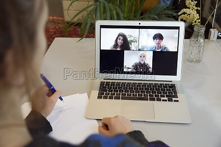 woman having video call with colleagues