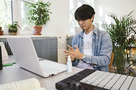 man using hand sanitizer at his