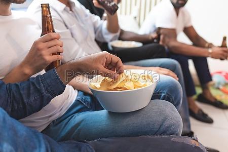 men having beer and snacks