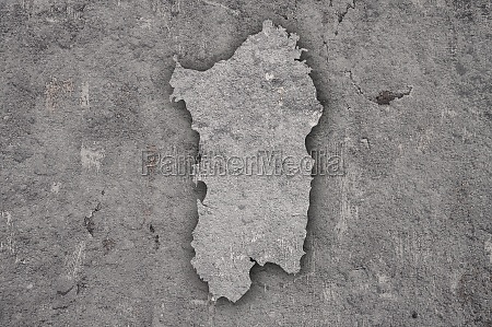 map of sardinia on weathered concrete