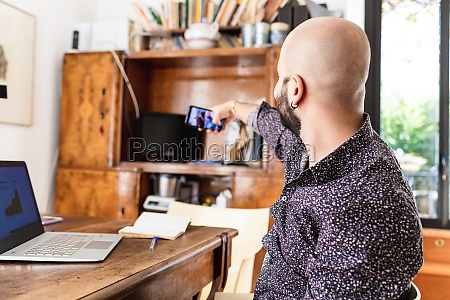 young man working at home having