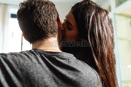 young woman kissing boyfriend