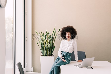 portrait of businesswoman in office with