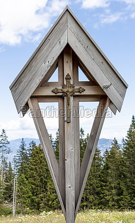 crucifix in metal and wood outdoors