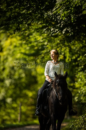 woman riding a horse equestrian sport