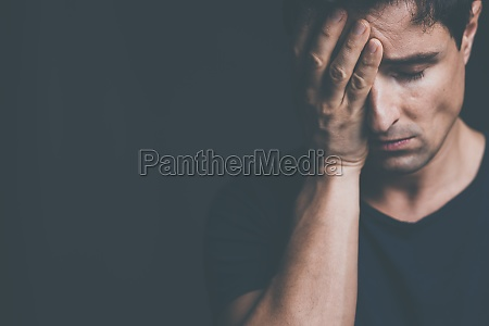 young man suffering from anxiety depression