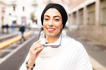 street portrait of stylish young woman