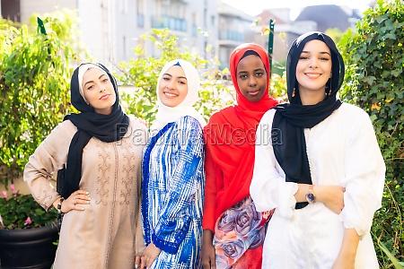 four young muslim women in garden